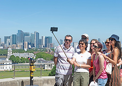 © Licensed to London News Pictures 09/06/2021. Greenwich, UK. A family selfie in the sun. Another hot sunny day in Greenwich park, London as temperatures across the UK are forecast to be hotter than Portugal at the weekend. Photo credit:Grant Falvey/LNP
