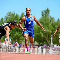051014       Adron Gardner<br /> <br /> Clayton Yellowjacket Koy Geary, left, tumbles across the finish line in first place past Laguna Acoma Hawk David McGee in second place during the AA boys 100m dash at  the New Mexico State Track meet at the New Mexico State Track meet at the University of New Mexico in Albuquerque Saturday.