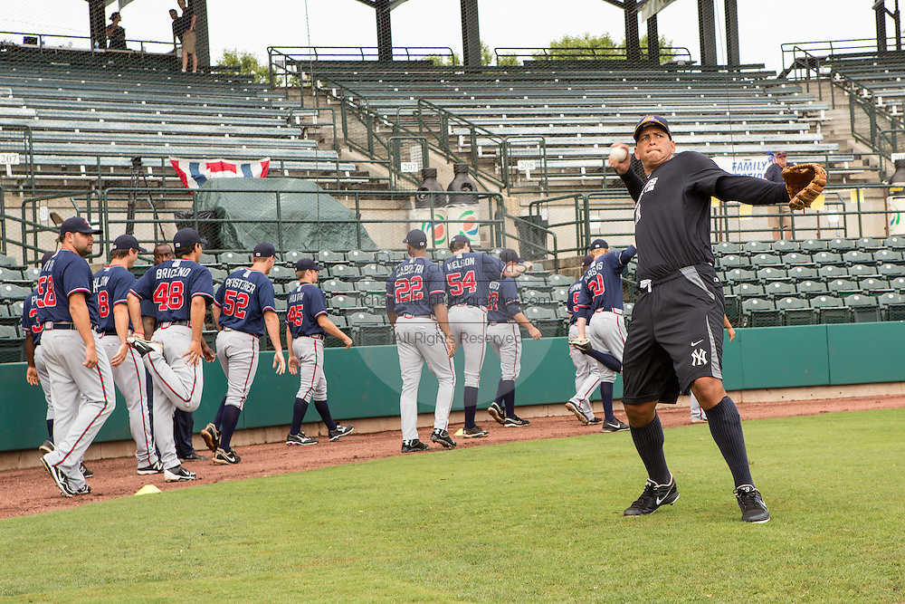 New York Yankees Alex Rodriguez rests during fielding practice before appearing in the first game since hip surgery with the minor league Charleston RiverDogs at Joseph P. Riley Jr. Stadium July 2, 2013 in Charleston, South Carolina.