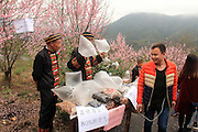 QINGYUAN, CHINA - MARCH 19: (CHINA OUT) <br /> <br /> Residents sell clean air to visitors in north area of Guangdong Province where mountains surround with clean air on March 19, 2016 in Qingyuan, Guangdong Province of China. Urban citizens in north China\'s Guangdong Province get away from smog-stricken cities to mountain-surrounded north areas and local residents think up an idea of selling clean air that a small bag of air sells 10 yuan and a larger one 30 yuan. The activity seems to be an effective way to promote environmental protect both in urban and rural areas, said a visitor.<br /> ©Exclusivepix Media