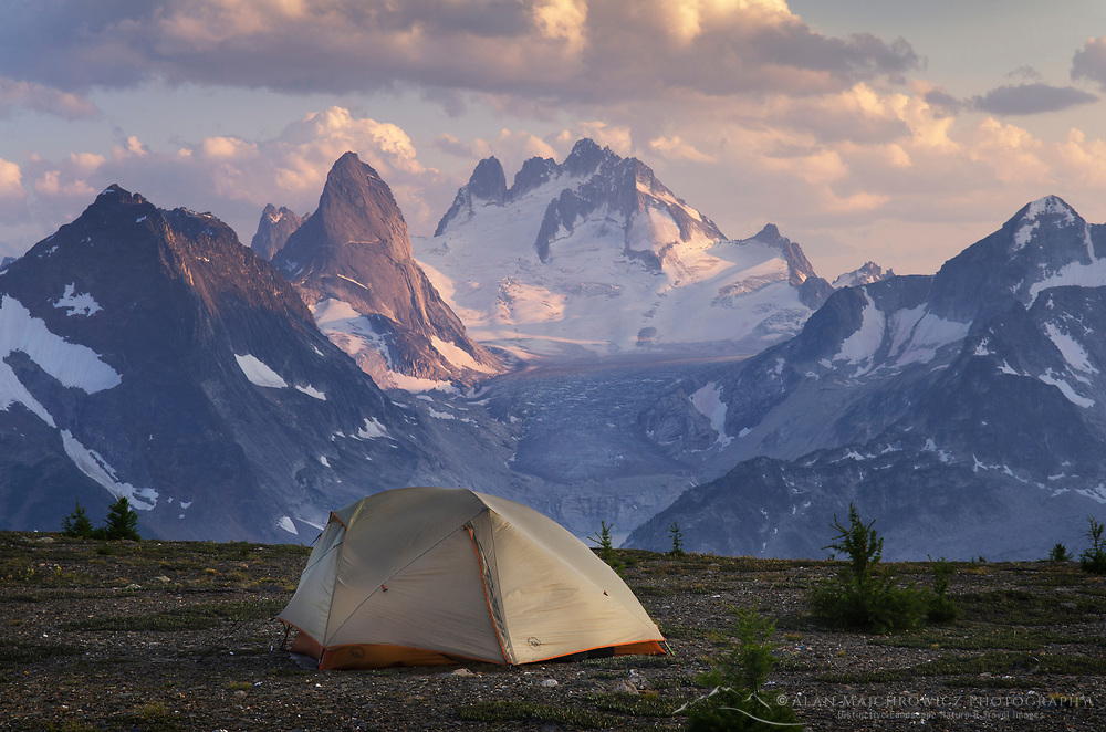 Tent at backcountry camp on Rocky Point Ridge. Howser Towers Vowell Glacier in the distance. Bugaboo Provincial Park Purcell Mountains British Columbia.