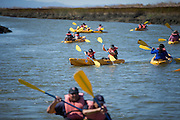 Families load into kayaks to experience Alviso's marsh more closely during Santa Clara County Park's Day on the Bay event at Don Edwards San Francisco Bay National Wildlife Refuge in Alviso, California, on October 9, 2016. (Stan Olszewski/SOSKIphoto)