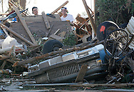 Josh Sallee (R) tries to move a brick wall from a tornado-destroyed home on Heather Lane in Moore, Oklahoma May 21, 2013. A massive tornado tore through a suburb of Oklahoma City, wiping out whole blocks and killing at least 24.   REUTERS/Rick Wilking (UNITED STATES)