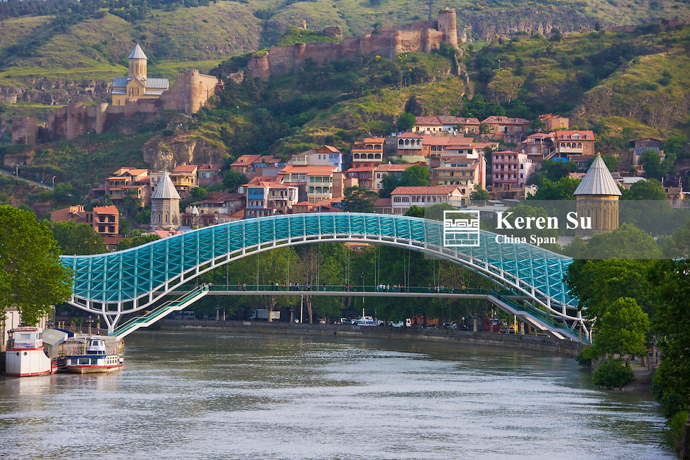 Bridge of Peace over Mt'k'vari (Kura) River and cityscape,Tbilisi, Georgia