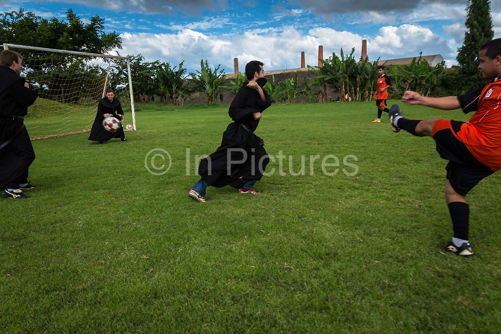 Priests of the Santo Tomás de Villanova seminary, play a game of football against student trainees. The seminarian football team has won many local trophies as they are amongst the best team in the region, Ourinhos, Brazil.