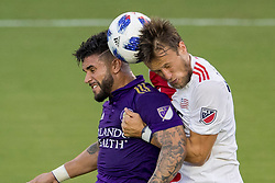 August 4, 2018 - Orlando, FL, U.S. - ORLANDO, FL - AUGUST 04: Orlando City forward Dom Dwyer (14) and New England Revolution defender Antonio Delamea Mlinar (19) collide while going for a header during the soccer match between the Orlando City Lions and the New England Revolution on August 4, 2018 at Orlando City Stadium in Orlando FL. (Photo by Joe Petro/Icon Sportswire) (Credit Image: © Joe Petro/Icon SMI via ZUMA Press)
