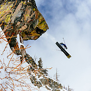 Tyler Hatcher skis off of a color saturated cliff in the Teton backcountry near Jackson Hole Mountain Resort, Teton Village, Wyoming.