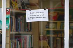 Philosophical statement in window of Oxfam second hand bookshop, Wallingford UK 2020