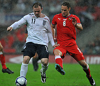 Photo: Tony Oudot/Richard Lane Photography.  England v Czech Republic. International match. 20/08/2008. <br /> Wayne Rooney of England is challenged by Jan Polak of the Czech Republic in the pouring rain