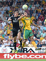 Photo: Ashley Pickering.<br /> Norwich City v Cardiff City. Coca Cola Championship. 01/09/2007.<br /> Stephen McPhail of Cardiff (L) challenges Darel Russell of Norwich in the air