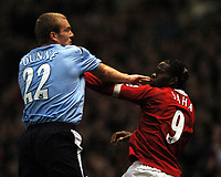 Photo: Javier Garcia/Digitalsport<br /> 07/11/2004 Manchester United v Manchester City, FA Barclays Premiership, Old Trafford<br /> Richard Dunne and Louis Saha square up after Dunne was fouled by the frenchman