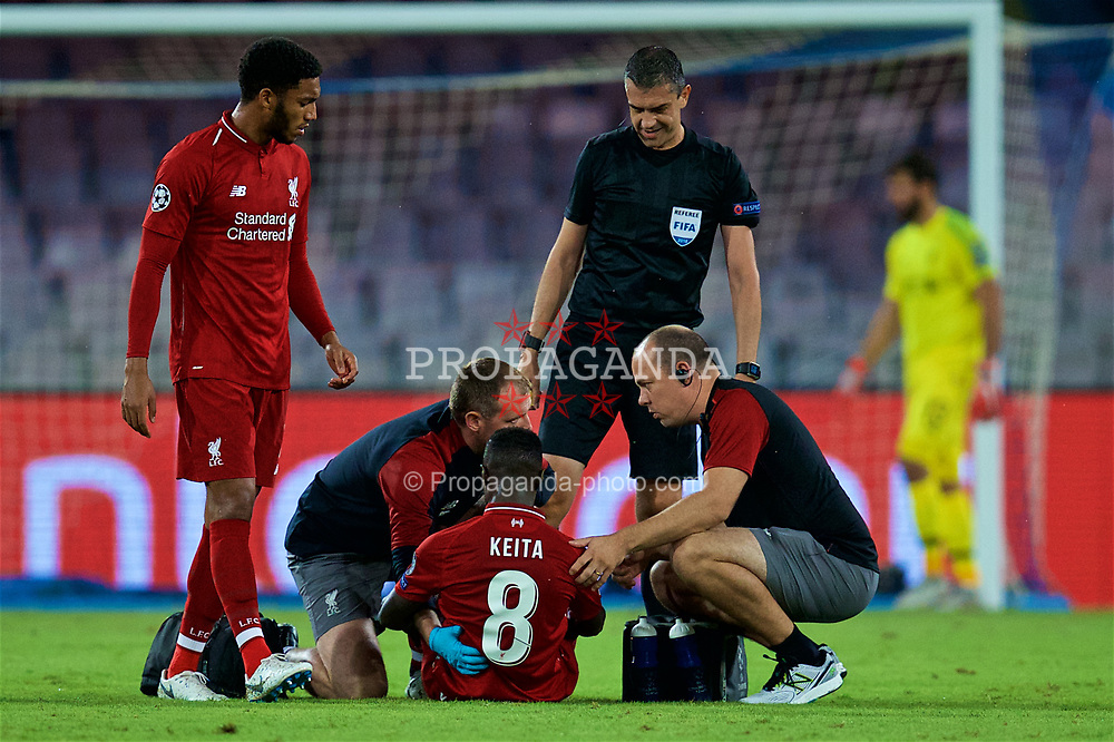 NAPLES, ITALY - Wednesday, October 3, 2018: Liverpool's Naby Keita is treated for a back injury during the UEFA Champions League Group C match between S.S.C. Napoli and Liverpool FC at Stadio San Paolo. (Pic by David Rawcliffe/Propaganda)
