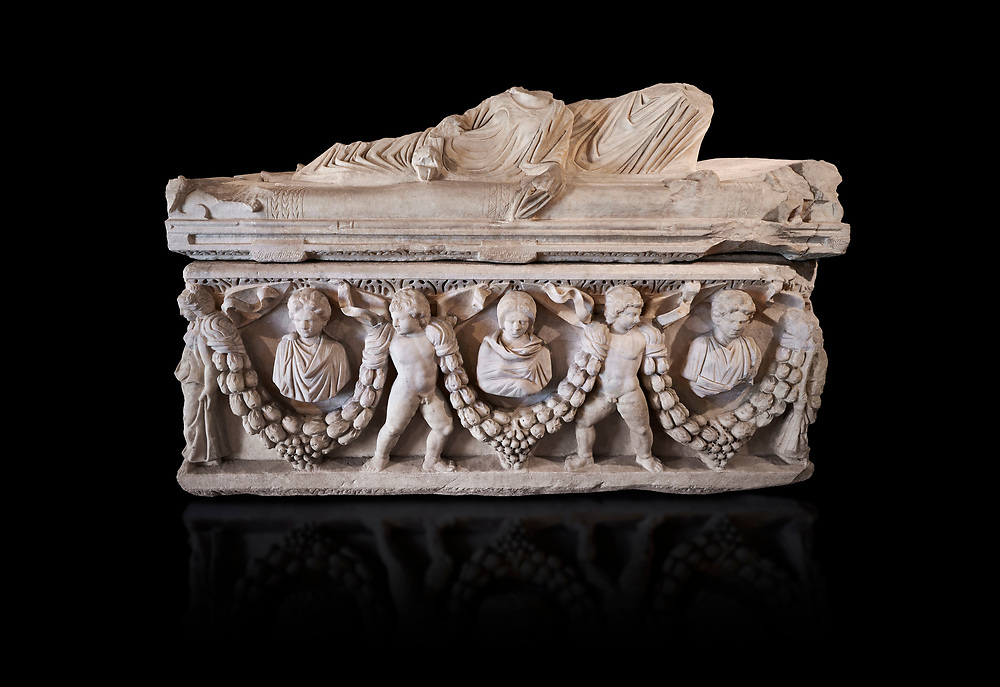 Roman relief garland  sculpted sarcophagus, style typical of Pamphylia, 3rd Century AD, Konya Archaeological Museum, Turkey. Against a black background .<br /> <br /> If you prefer to buy from our ALAMY STOCK LIBRARY page at https://www.alamy.com/portfolio/paul-williams-funkystock/greco-roman-sculptures.html . Type -    Konya     - into LOWER SEARCH WITHIN GALLERY box - Refine search by adding a subject, place, background colour, museum etc.<br /> <br /> Visit our ROMAN WORLD PHOTO COLLECTIONS for more photos to download or buy as wall art prints https://funkystock.photoshelter.com/gallery-collection/The-Romans-Art-Artefacts-Antiquities-Historic-Sites-Pictures-Images/C0000r2uLJJo9_s0