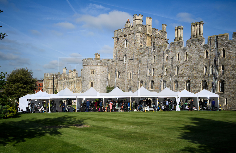 © Licensed to London News Pictures. 18/05/2018. London, UK. Media outlets gather in the Grounds on Windsor Castle Windsor Castle. Prince Harry and Meghan Markle are to be married tomorrow (Saturday) at St George's Chapel in Windsor. Photo credit: Ben Cawthra/LNP