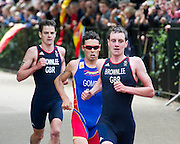 The Brownlee brothers, Alistair and Jonathan form the backbone of  Team GB men's triathlon and go on to win Gold and Bronze medals. They are well supported by Stuart Hayes who leads the pack for some of the bike leg. Hyde Park, London, UK, 05 Aug 2102. Guy Bell, gbphotos.com