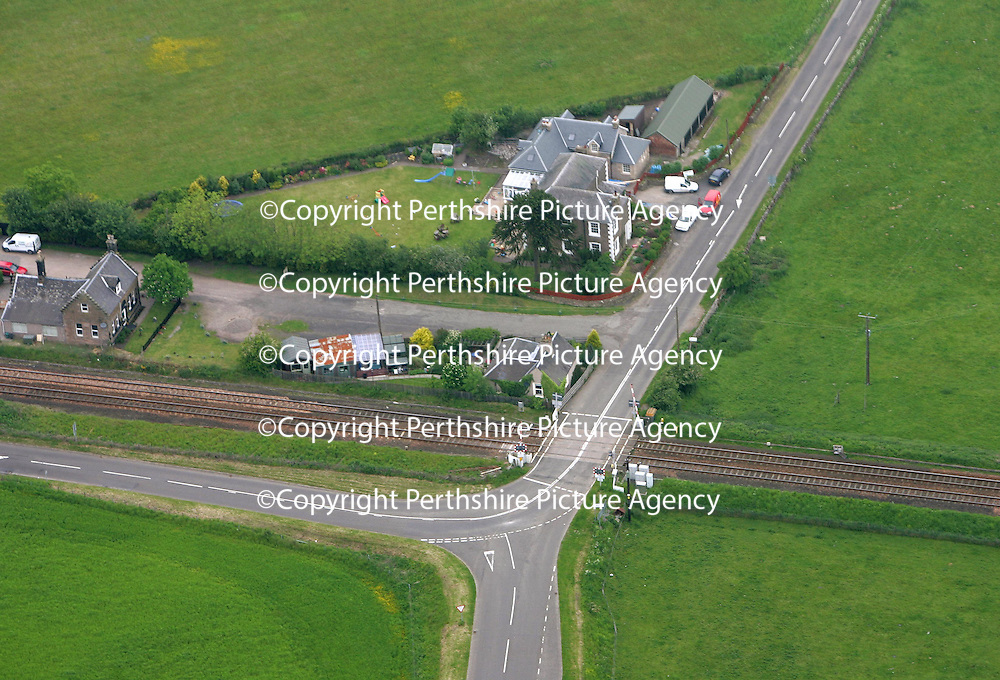 Aerial view of Dunning-Forteviot level crossing<br /><br />Picture by Graeme Hart.<br />Copyright Perthshire Picture Agency<br />Tel: 01738 623350  Mobile: 07990 594431