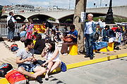 Spring community activities on The Southbank, London. British seaside in central London, on a 70-metre urban beach that appears on Queen's Walk for the duration of the Festival of Britain celebrations.