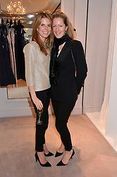 Left to right, CATHERINE CADBURY and JULIET FETHERSTONHAUGH at a party at Herve Leger, Lowndes Street, London on 12th November 2014 to view the latest collection.