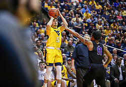 Mar 20, 2019; Morgantown, WV, USA; West Virginia Mountaineers guard Jordan McCabe (5) shoots a three pointer during the second half against the Grand Canyon Antelopes at WVU Coliseum. Mandatory Credit: Ben Queen