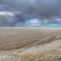 Tire tracks and storm clouds on the Bonneville Salt Flats, Utah