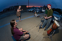 A sunset party on the top level of the Laconia Parking Garage Tuesday, July 17, 2012.