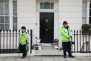 London, UK. Wednesday 10th April 2013. Police on duty outside former British Prime Minister Margaret Thatcher's house in London.