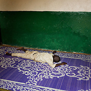November 29th 2013, a street boy sleeps on a prayer rug in the main mosk of the Bangui in the Muslim district called 5kilo.