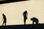 18 AUGUST 2020 - CEDAR RAPIDS, IOWA: A shadow of roofers at work on the wall next to the building they are working on at an apartment complex on the west side of Cedar Rapids. The complex was severely damaged by the wind storm and has been evacuated. Cedar Rapids was the state's hardest hit city by the derecho that roared across Iowa last week. City officials said the damage left by the derecho was more extensive than the 2008 flood that destroyed much of its downtown. City residents are reporting that almost every home was damaged in the storm, many businesses were closed, and up to half of the city's tree canopy was destroyed. A week after the storm, more than 40,000 homes were still without power. A spokesman for Alliant Energy said the utility has replaced as many power poles in one week that they normally replace in 8 months. On Monday, President Trump approved a $4 billion emergency declaration for Iowa to aid in derecho recovery.      PHOTO BY JACK KURTZ