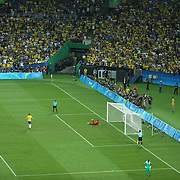Football - Olympics: Day 15  Renato Augusto #5 of Brazil scores from the penalty spot during the penalty shoot out beating Timo Horn #1 of Germany during the Brazil Vs Germany Men's Football Gold Medal Match at Maracana on August 20, 2016 in Rio de Janeiro, Brazil. (Photo by Tim Clayton/Corbis via Getty Images)