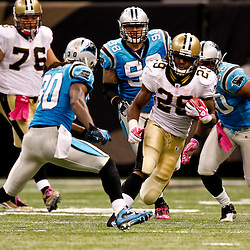 October 3, 2010; New Orleans, LA, USA; Carolina Panthers safety Charles Godfrey (30) pursues New Orleans Saints running back Chris Ivory (29) during the second half at the Louisiana Superdome. The Saints defeated the Panthers 16-14. Mandatory Credit: Derick E. Hingle