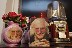 © licensed to London News Pictures. London, UK 24/10/2012. Pictures of Jimmy Savile positioned next to flowers at 'Jimmy Savile is innocent' exhibition at Bread and Butter Gallery in Islington. Photo credit: Tolga Akmen/LNP