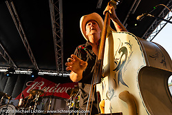 Mark Robertson playing bass with the Eskimo Brothers Band on Main Street for the 78th annual Sturgis Motorcycle Rally. Sturgis, SD. USA. Saturday August 4, 2018. Photography ©2018 Michael Lichter.