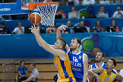 04.09.2013, Arena Bonifka, Koper, SLO, Eurobasket EM 2013, Schweden vs Griechenland, im Bild Joakim Kjellbom #6 of Sweden lays the ball up against Loukas Mavrokefalidis #12 of Greece // during Eurobasket EM 2013 match between Sweden and Greece at Arena Bonifka in Koper, Slowenia on 2013/09/04. EXPA Pictures © 2013, PhotoCredit: EXPA/ Sportida/ Matic Klansek Velej<br /> <br /> ***** ATTENTION - OUT OF SLO *****