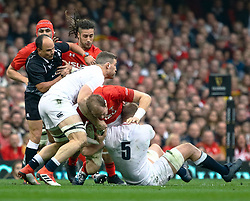 Alun Wyn Jones of Wales under pressure from Mark Wilson of England<br /> <br /> Photographer Simon King/Replay Images<br /> <br /> Six Nations Round 3 - Wales v England - Saturday 23rd February 2019 - Principality Stadium - Cardiff<br /> <br /> World Copyright © Replay Images . All rights reserved. info@replayimages.co.uk - http://replayimages.co.uk