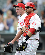 CHICAGO - AUGUST 12:  A.J. PIerzynski #12 and closer Addison Reed #43 of the Chicago White Sox look on after the game against the Oakland Athletics on August 12, 2012 at U.S. Cellular Field in Chicago, Illinois.  The White Sox defeated the Athletics 7-3.  (Photo by Ron Vesely)   Subject: A.J. Pierzynski; Addison Reed