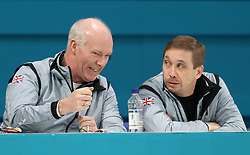 Great Britain coach Glenn Howard (left) talks tactics during the Women's Semi-Final against Sweden at the Gangneung Curling Centre during day fourteen of the PyeongChang 2018 Winter Olympic Games in South Korea.