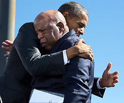 President Barack Obama hugs Rep. John Lewis, D-Ga. after his introduction during the event to commemorate the 50th Anniversary of Bloody Sunday and the Selma to Montgomery civil rights marches, at the Edmund Pettus Bridge in Selma, Ala., March 7, 2015. (Official White House Photo by Pete Souza)<br /> <br /> This official White House photograph is being made available only for publication by news organizations and/or for personal use printing by the subject(s) of the photograph. The photograph may not be manipulated in any way and may not be used in commercial or political materials, advertisements, emails, products, promotions that in any way suggests approval or endorsement of the President, the First Family, or the White House.
