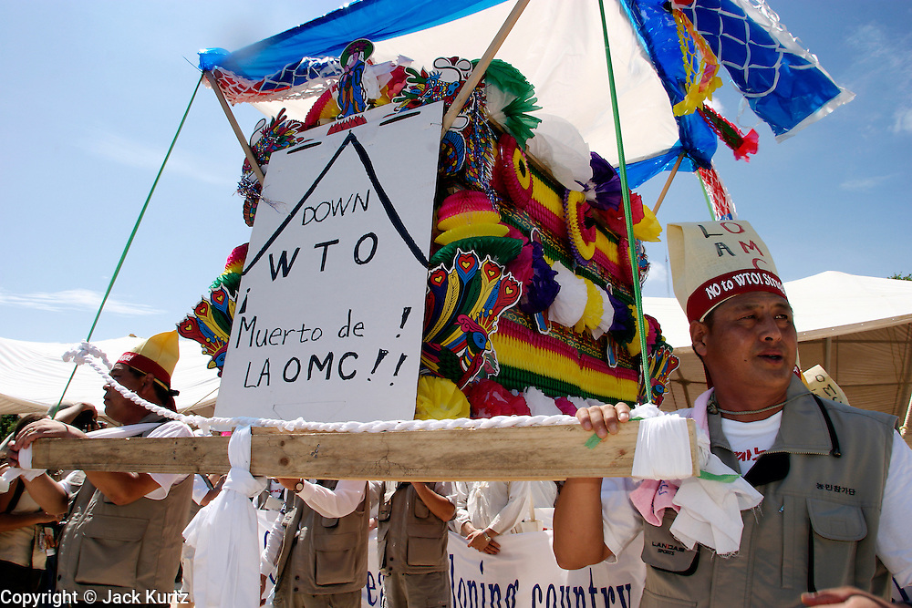 10 SEPTEMBER 2003 - CANCUN, QUINTANA ROO, MEXICO: Korean protestors opposed to the World Trade Organization and globalization participate in an anti-WTO rally in the city of Cancun, Quintana Roo, Mexico. Lee Kyung-hae, one of the Korean protestors killed himself by stabbing himself in the chest during the protest. Kyung-hae killed himself to protest WTO farm policies. Tens of thousands of people opposed to the WTO have come to this Mexican resort city to protest the 5th Ministerial meeting of the World Trade Organization. The WTO meetings are taking place in the hotel zone of Cancun, about 10 miles from the protestors.  PHOTO BY JACK KURTZ