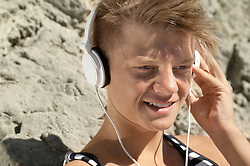 Close-up portrait male teenager headphones music