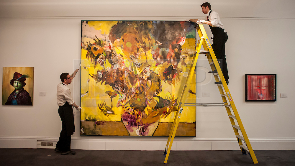 """© Licensed to London News Pictures. 28/01/2016. London, UK.   Technicians install """"The Sunflowers"""" by Adrien Ghenie (est. £0.4-0.6m), on display at Sotheby's preview of its upcoming Impressionist, Modern & Surrealist art sale on 3 February featuring works by some of the most important artists of the 20th century.  The combined total of the evening sale is expected to exceed £100m. Photo credit : Stephen Chung/LNP"""