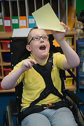 Boy with Cerebral Palsy celebrating success in a lesson,