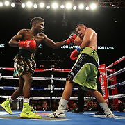 """Welterweight fighter Erickson """"Hammer"""" Lubin (left) fights against Noe Bolanos during the """"Judgement Day"""" boxing event at American Airlines Arena on Thursday, July 10, 2014 in Miami, Florida.  (AP Photo/Alex Menendez)"""