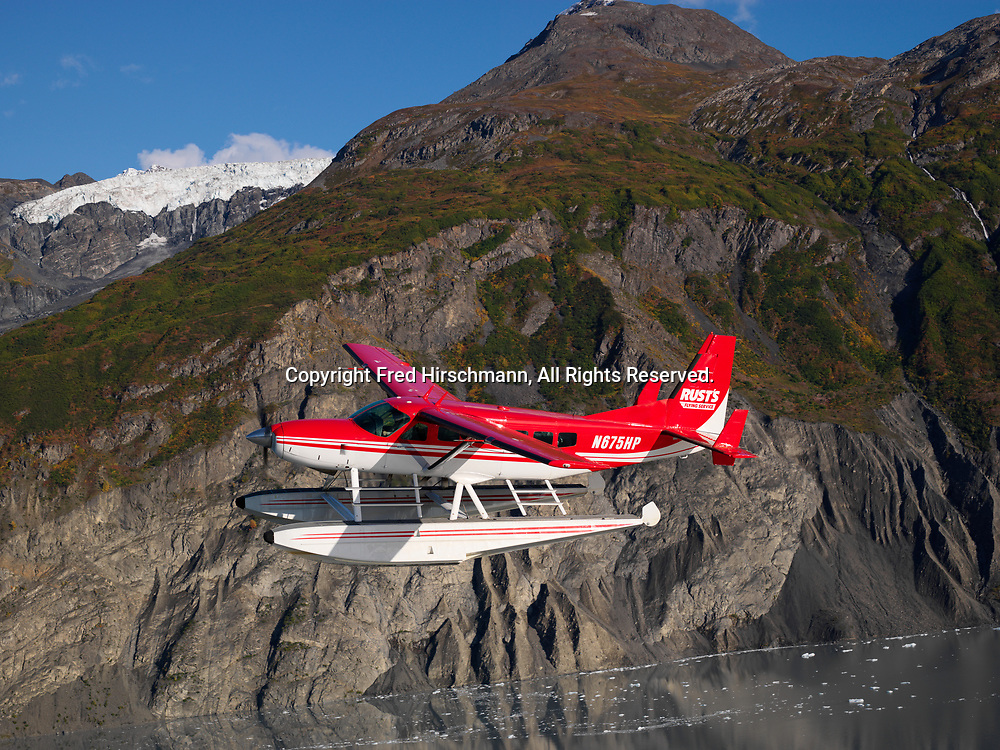 Rust's Flying Service Cessna 208 Caravan on floats flying above Lake George, Alaska.