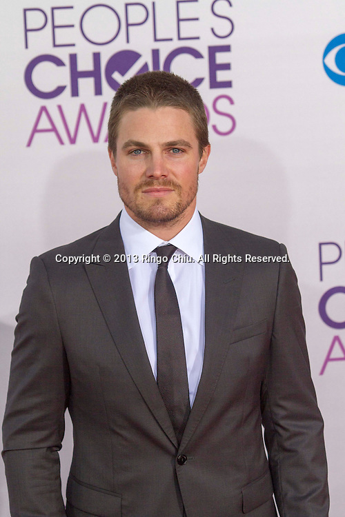 Stephen Amell arrives at the 39th Annual People's Choice Awards at Nokia Theatre L.A. Live on Wednesday January 9, 2013 in Los Angeles, California, United States. (Photo by Ringo Chiu/PHOTOFORMULA.com)