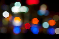 Digital background of colorful city lights bokeh.
