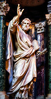 """""""Saint Peter in the Papal Archbasilica of St. John Lateran""""…<br /> <br /> Mt 16:13-19 """"When Jesus went into the region of Caesarea Philippi he asked his disciples, 'Who do people say that the Son of Man is?"""" They replied, """"Some say John the Baptist, others Elijah, still others Jeremiah or one of the prophets.' He said to them, """"But who do you say that I am?"""" Simon Peter said in reply, """"You are the Christ, the Son of the living God."""" Jesus said to him in reply, """"Blessed are you, Simon son of Jonah. For flesh and blood has not revealed this to you, but my heavenly Father. And so I say to you, you are Peter, and upon this rock I will build my Church, and the gates of the netherworld shall not prevail against it. I will give you the keys to the Kingdom of heaven. Whatever you bind on earth shall be bound in heaven; and whatever you loose on earth shall be loosed in heaven."""" San Giovanni in Laterano was the first Christian/Catholic church erected in Rome. In 1702, Pope Clement XI announced a grand scheme for twelve sculptures of the Apostles to fill the niches left in the nave of the Basilica. The commission was opened to all the premier sculptors of late Baroque Rome, and the Pope himself sponsored this sculpture of Saint Peter, which was completed by Pierre-Étienne Monnot. One cannot help being impressed by the larger than life statues of these great men blessing the nave with their imposing presence. This statue of Saint Peter, the first Pope, stood out to me more so than the others because of its extreme detail, his piercing stare, and his forward hand touched by God. I found the perfect angle as if he was looking straight at me to create this image. I photographed all twelve apostles, including Saint Paul, and none appeared as lifelike as this one of Saint Peter. Look deeply into his eyes, and I believe you will feel the presence of God."""