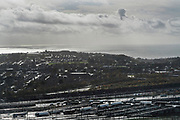 Eurotunnel Folkestone to Calais. View over Folkestone and in the foreground lorries entering the Channel Tunnel railway system. With Brexit, international check ups and paperwork could cause severe delays, with hundreds of lorries crossing every day, that could add hours if not days of processing