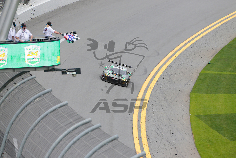 Daytona Beach, FL - Jan 31, 2016:  The Magnus Racing Audi takes the checkered flag for the Rolex 24 at Daytona at Daytona International Speedway in Daytona Beach, FL.