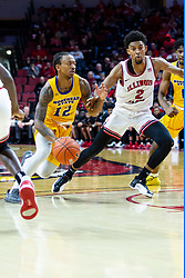 NORMAL, IL - December 07: Justin Thomas drives the court defended by Zach Copeland during a college basketball game between the ISU Redbirds and the Morehead State Eagles on December 07 2019 at Redbird Arena in Normal, IL. (Photo by Alan Look)