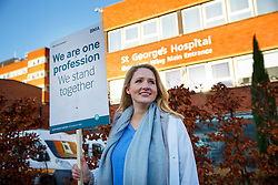 © Licensed to London News Pictures. 12/01/2016. London, UK. A juniors doctor Stephanie Fraser at a picket line outside St George's Hospital in Tooting, south London as junior doctors in England have gone on strike in a dispute with the government over a new contract on Tuesday, 12 January 2015. Photo credit: Tolga Akmen/LNP